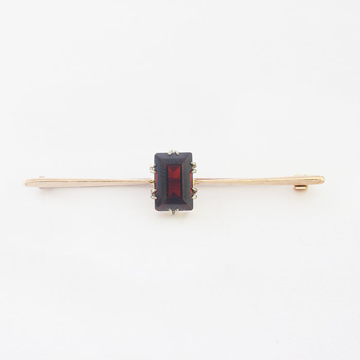 a secondhand yellow gold garnet single stone bar brooch