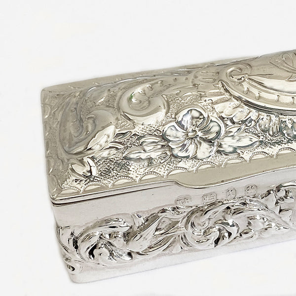 a victorian silver rectangular embossed box with initials and scroll floral design 1897