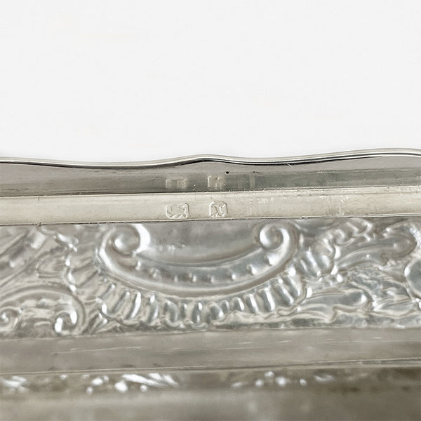 a secondhand silver rectangular small trinket box with floral pattern and initials dated birmingham 1897