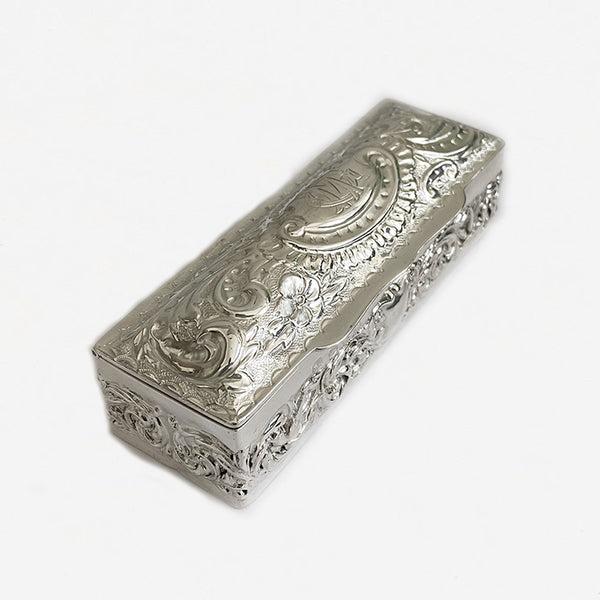 a victorian silver rectangular embossed box with initials and scroll floral design 1897 marston barrett in lewes