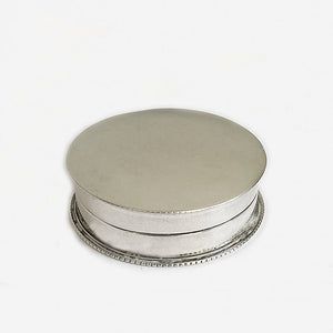 a silver victorian small circular box with bead edge dated 1898