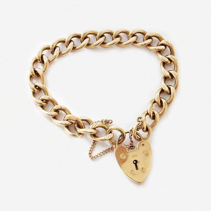 a fine quality vintage yellow gold 9 carat charm bracelet with padlock and safety chain