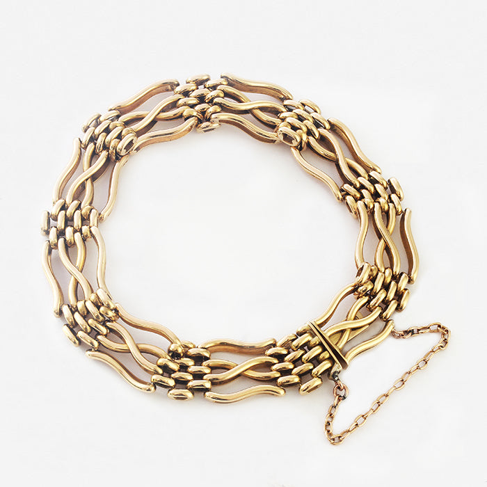 a secondhand heavy 18 carat gold gate bracelet with safety chain