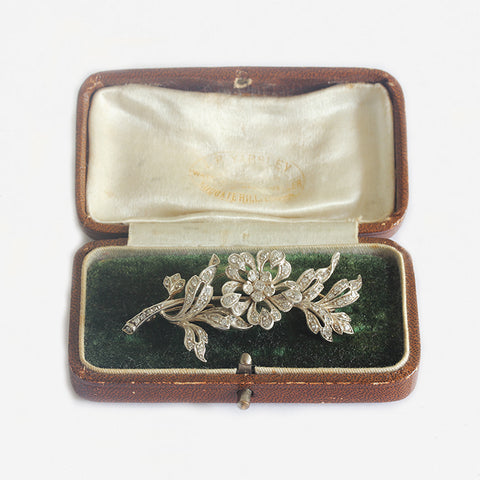 a beautiful diamond floral spray brooch in platinum yellow gold with box