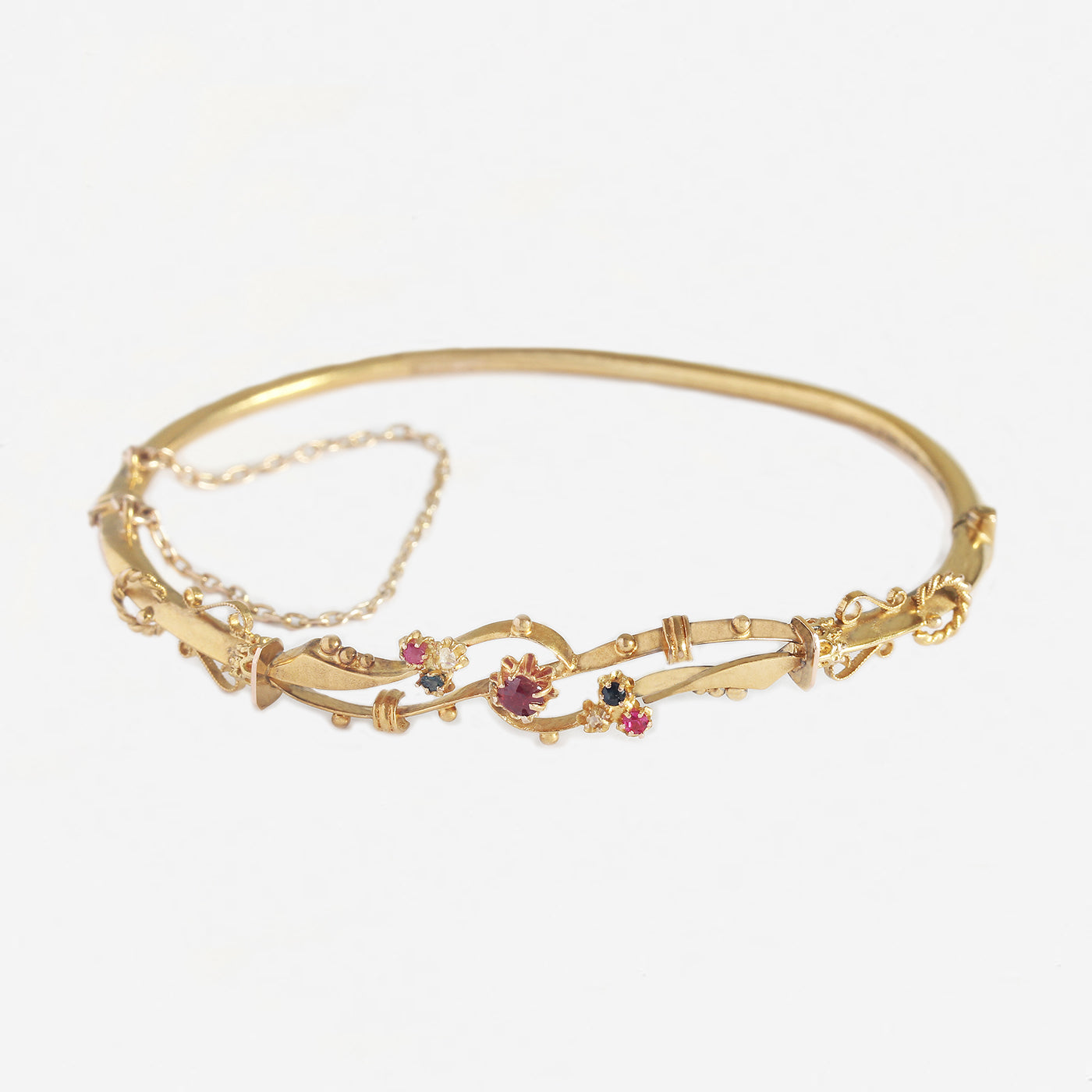 a ruby sapphire diamond victorian yellow gold oval hinged bangle