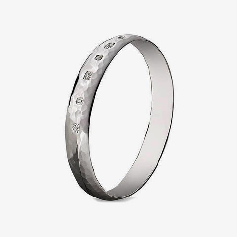 a gents sterling silver bangle with a hammered pattern and large hallmark
