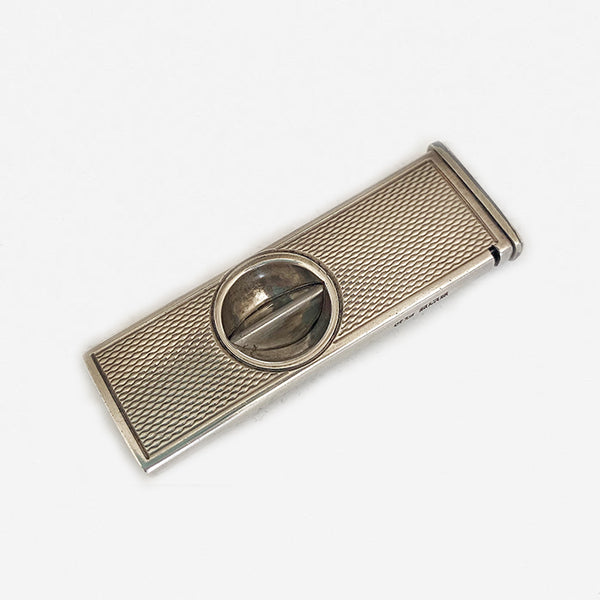 a silver pocket cigar cutter dated 1967