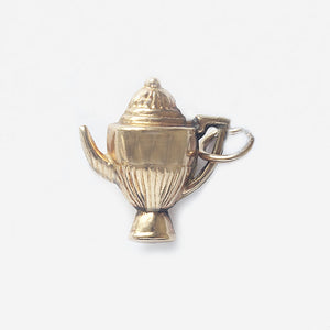 a yellow gold coffee pot hollow charm