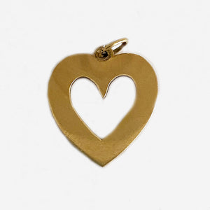 a yellow gold cut out heart charm secondhand by maker tiffany and co