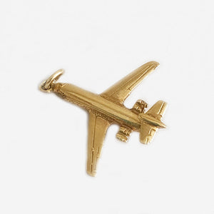 a secondhand yellow gold detailed plane charm for a bracelet