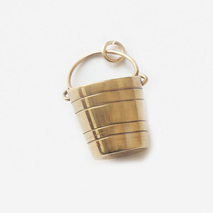 a vintage yellow gold plain grooved bucket charm for a bracelet