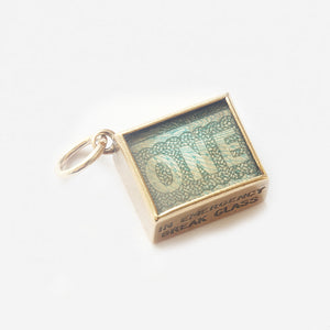 a vintage secondhand one pound note in a gold box