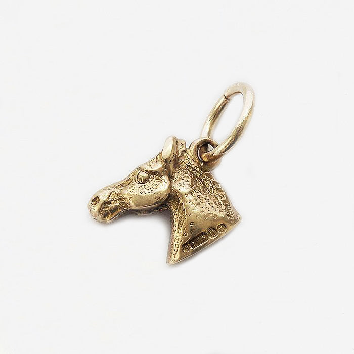a fine quality detailed horse head charm in yellow gold and secondhand