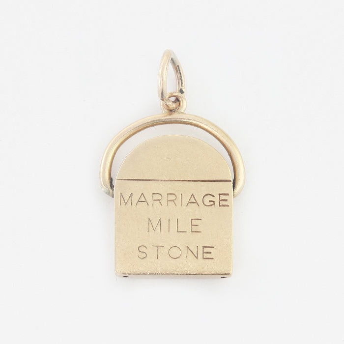 a vintage yellow gold marriage mile stone charm for a charm bracelet