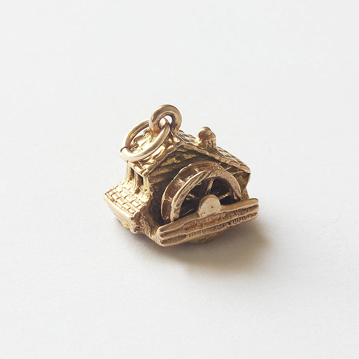 a fine quality secondhand water mill gold charm for a bracelet