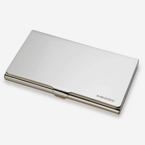 a rectangular silver credit card holder plain design with hallmark in the corner edge