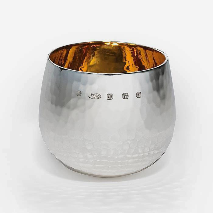 a britannia silver brandy tumbler with dimpled pattern and full hallmark
