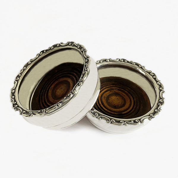 an Edwardian silver pair of coasters with patterned edge dated 1903