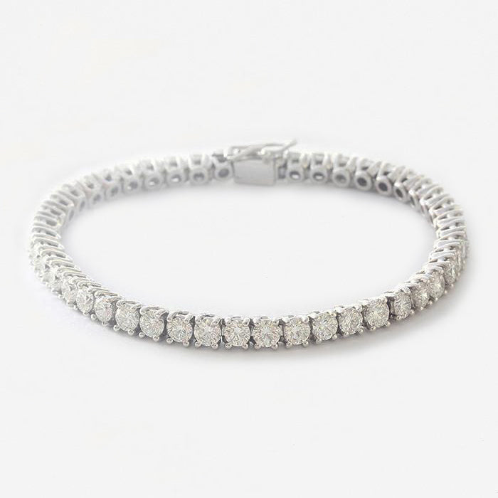 a beautiful secondhand diamond set line bracelet all made in 18 carat white gold