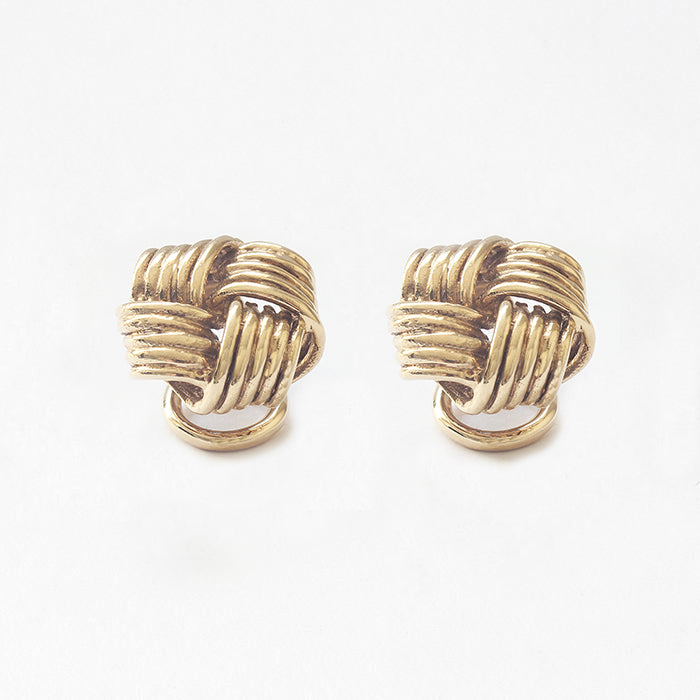 a secondhand pair of yellow gold classic knot design studs with clip on fittings