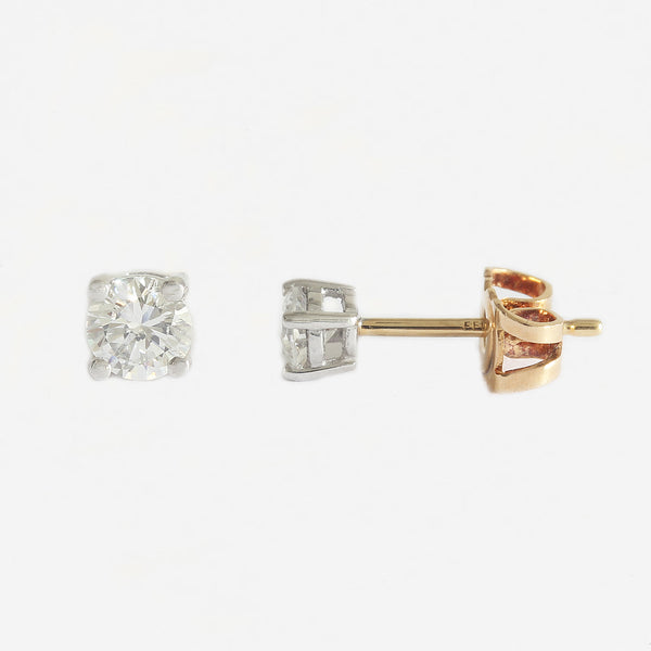 a secondhand pair of diamond round solitaire claw set earrings