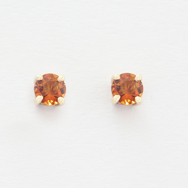 a citrine round stud earring in claw setting and yellow gold 4mm