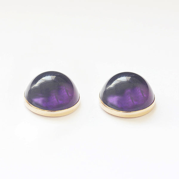 a pair of amethyst cabochon round domed stud earrings in yellow gold