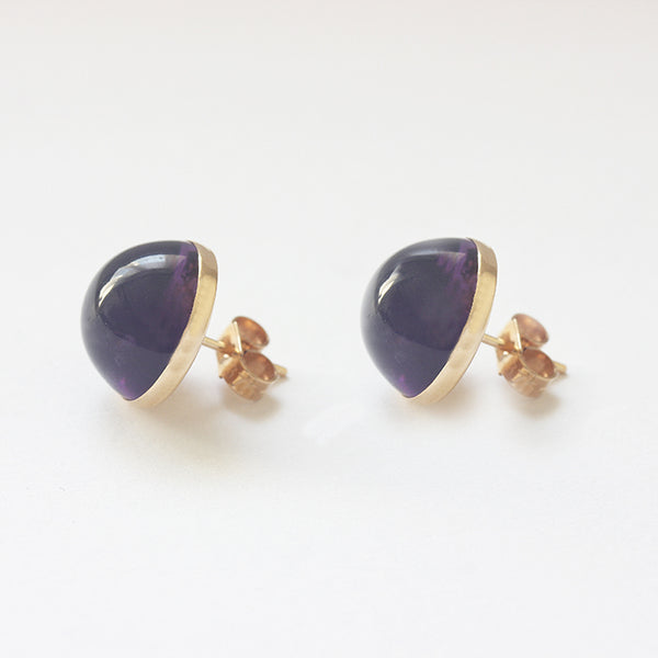 a pair of amethyst domed cabochon gold studs domed shaped