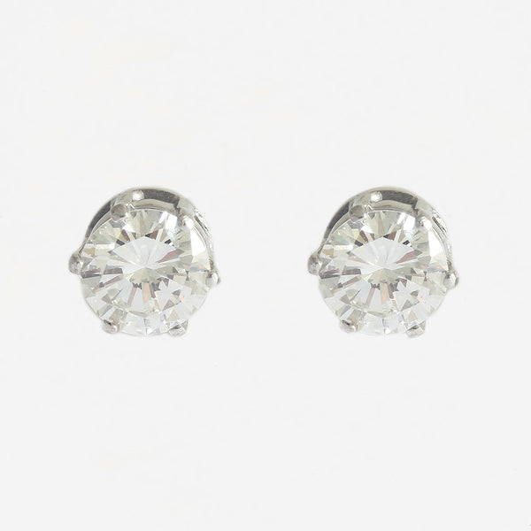 a secondhand pair of white gold round diamond stud earrings with 6 claw setting