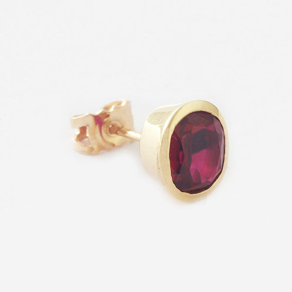 a secondhand pair of yellow gold ruby oval stud earrings with butterfly fittings