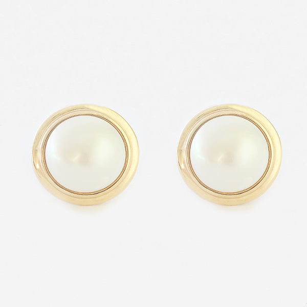 mabe pearl clip earrings with a gold border