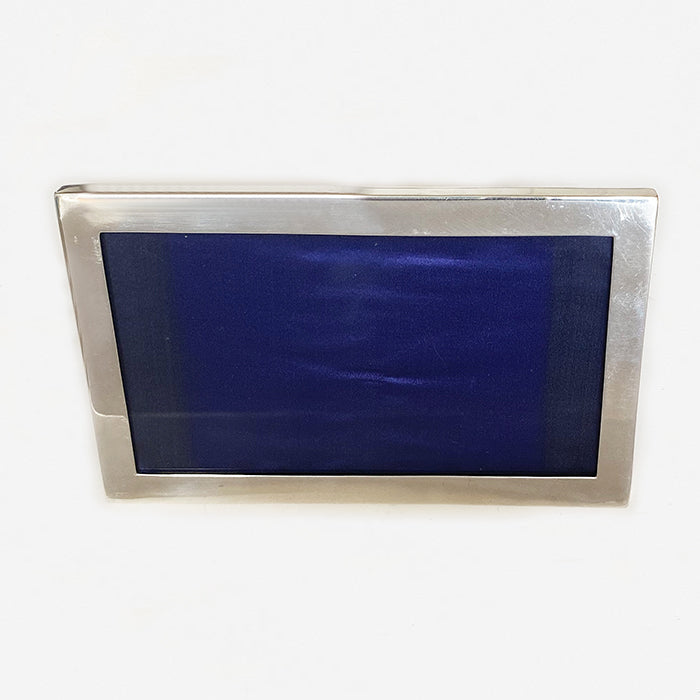 a rectangular plain silver landscape photo frame dated 1925