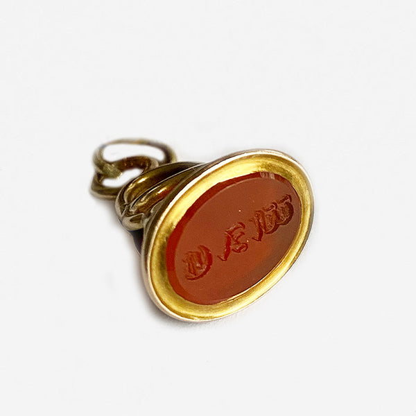a vintage old gold fob with a cornelian stone