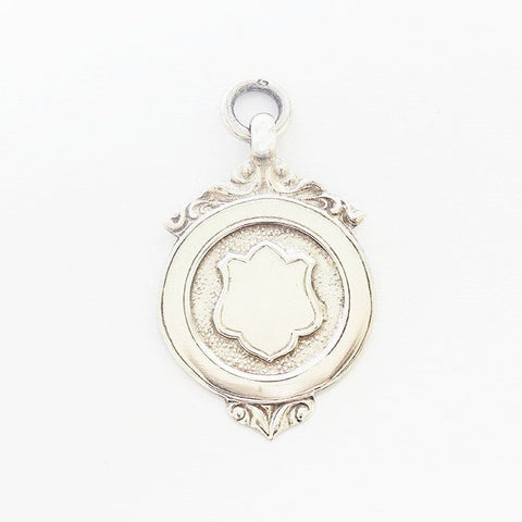 a fine quality vintage silver fob with shield shape motif and scroll edges dated 1937