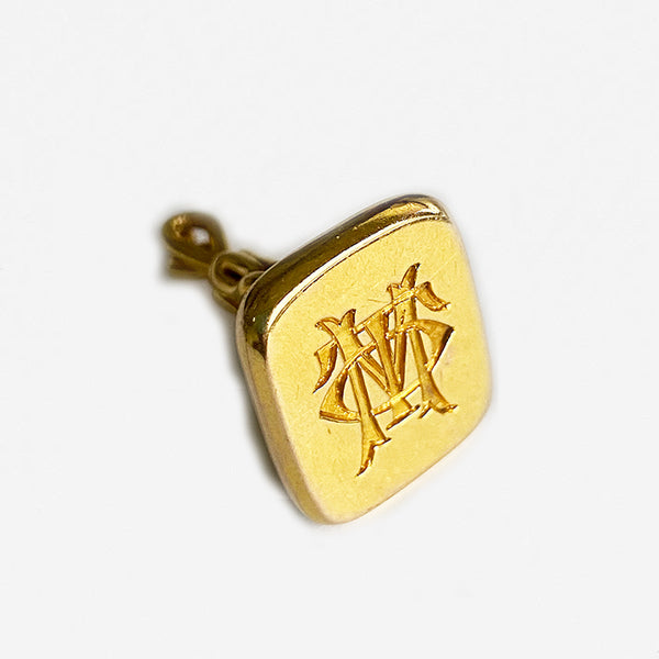 a preowned gold old seal fob with initials dated 1911