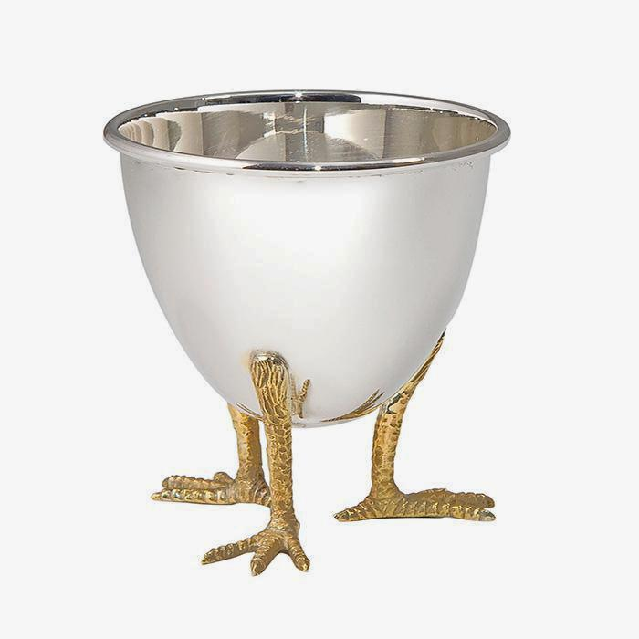 a sterling silver egg cup with chicken feet in a gilt finish by francis howard in sheffield