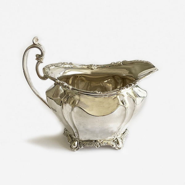 a beautiful solid silver cream jug dated 1902