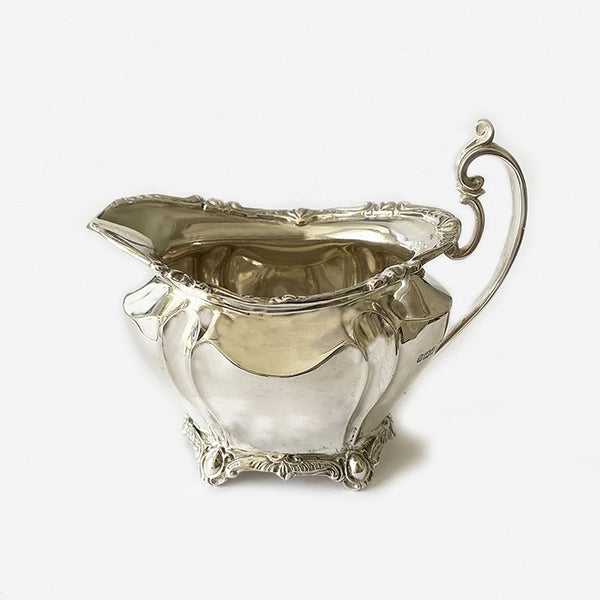 an edwardian cream jug dated 1902 in silver