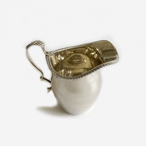 plain silver cream jug dated 1931