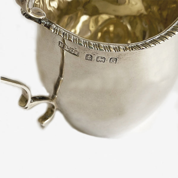 a secondhand vintage silver cream jug with hallmarks for birmingham 1931