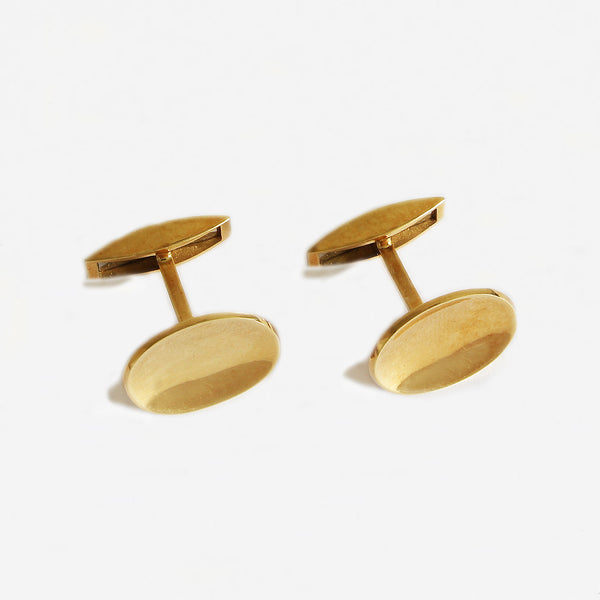 a fine quality yellow gold pair of plain oval cufflinks with box dated 1988
