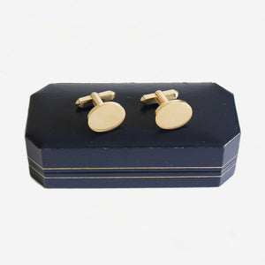 a secondhand pair of 9 carat yellow gold plain oval solid cufflinks with t bar fitting