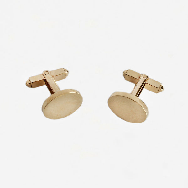 a pair of yellow gold oval plain solid cufflinks with bar fittings and box