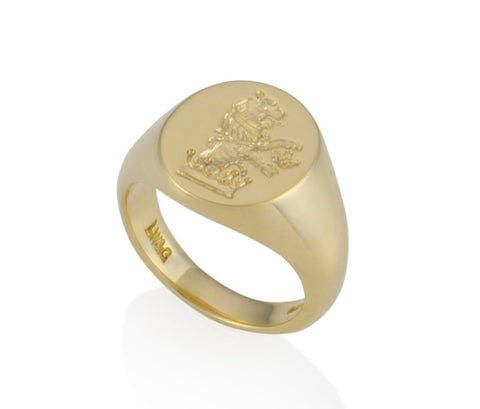 a gold oval signet ring 16mm x 13mm