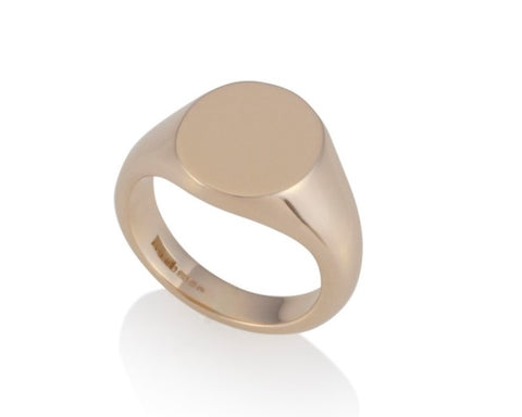 a gold oval signet ring 13.5mm x 11.5mm