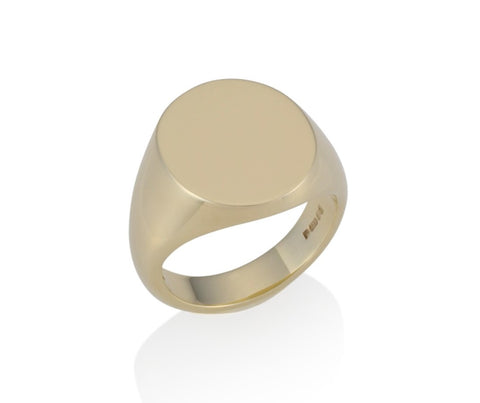 a gold oval signet ring 19mm x 16mm