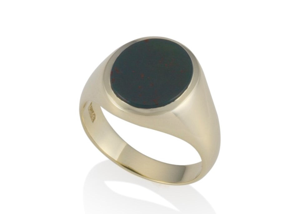 a gold oval stone set signet ring 14.5mm x 12.5mm