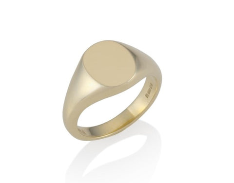 a gold oval signet ring 11mm x 9mm