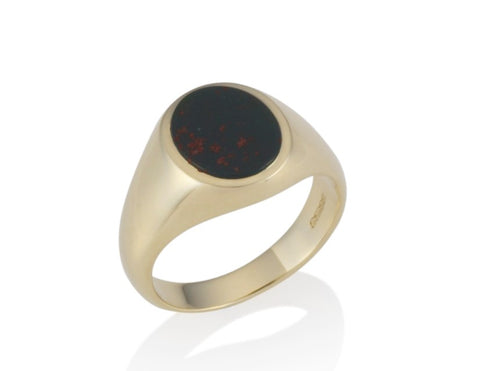 a gold oval stone set signet ring 11mm x 9mm