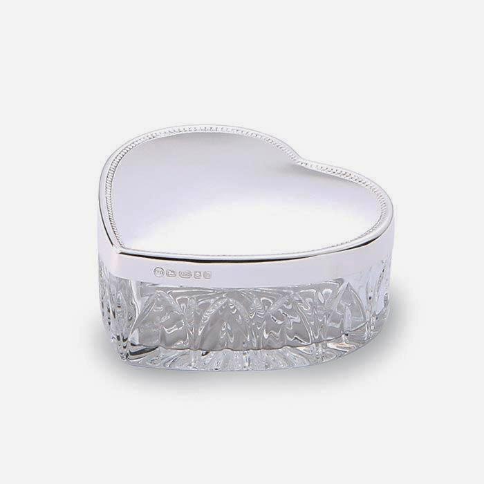 a silver topped heart shaped box with a crystal base with a full hallmark modern item